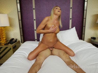 Barely legal blonde rides his cock with painful looking face