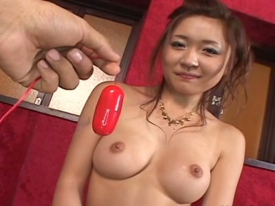 Round face Jap cutie Haruka Kaede testing vibrator on her pussy