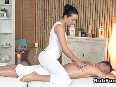 Handsome dude fucks sexy brunette masseuse