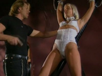 Lascivious blonde Stacey Burke in white lingerie getting undressed for BDSM