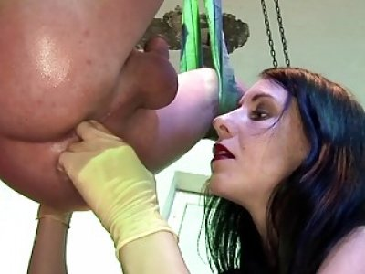 Luscious strap-on Mistress knows how to stimulate masked slave's prostate