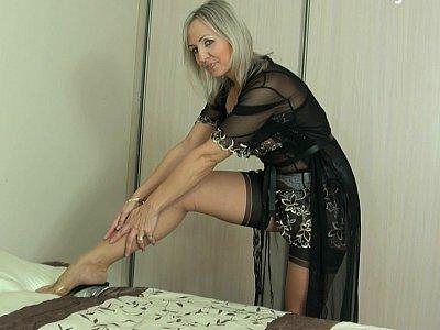Mature wearing a garter belt and sexy lingerie