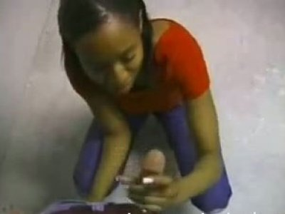 Cheesy black wench gives an awesome handjob