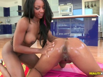 Two oiled girls rubbing agains each other
