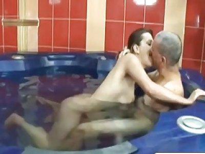 Brunette gets banged by one armed stud in bathroom