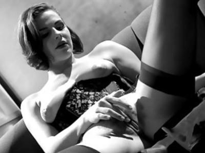 Bobbi S masturbates in a corset and stockings